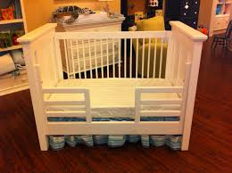 when to convert crib into toddler bed baby nursery kids bed frame with safety rails white blue fabric
