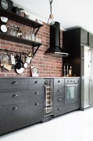 red brick backsplash black cabinet deco pinterest black