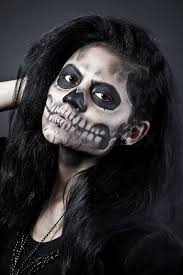 young woman in day of the dead mask skull face art halloween face