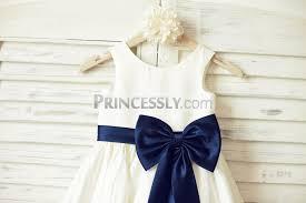 ivory satin sleeveless flower dress with navy blue belt bow