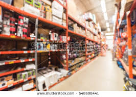 Interior Home Improvement by Blurred Large Hardware Store Forklifts Defocused Stock Photo