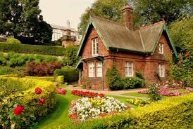 outdoor a house with a garden full of flowers and plants then