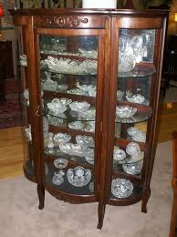 walnut bow front antique china cabinet