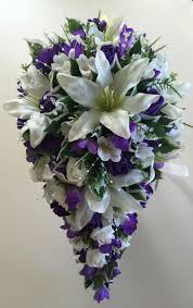 wedding bouquets brides teardrop bouquet in ivory lilac and purple wedding flowers