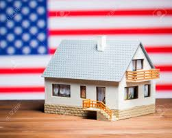 American Flag House Usa Real Estate Concept House Against American Flag Stock Photo