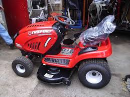 troy bilt pony riding lawn mower to replace the drive belts on a