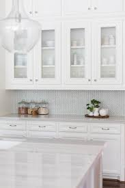 sacks kitchen backsplash white and gray kitchen features white cabinets paired with new