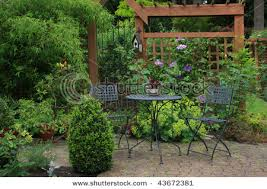 Cozy Backyard Ideas Of A Cozy Little Back Yard Terrace With Table And Chair And Lots