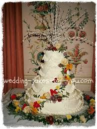 imagine fall wedding cakes with bright and colorful autumn flowers