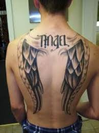 wing tattoos at back or artist ideas