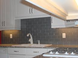 interior subway tile kitchen backsplash with grey glass subway