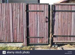 pink solid wooden country style fence with gate stock photo