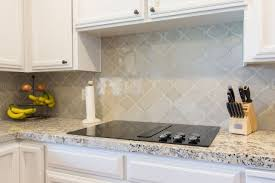bianco antico granite with white cabinets arabesque tile backsplash bianco antico granite countertop with
