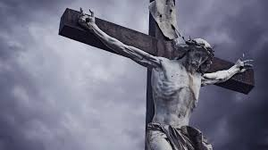 crucifixion christian cross with jesus christ statue over stormy