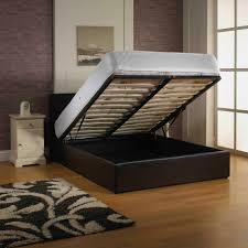 black low profile bed with storage under the bed plus white