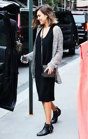 jessica alba wears a black tank dress gray sweater black studded