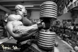 Ronnie Coleman Bench Photo Of Ronnie Coleman Looking Good With Light Weight In Hand