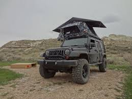 commando jeep hendrick jeep wrangler jk with tepui kukenam roof top tent parked at