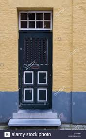 old blue wooden front door in need of painting door is main