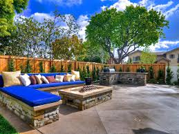 stunning modern backyard idea with blue seat cushion and outdoor
