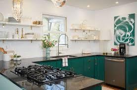 green kitchen cabinets white countertops white kitchen with black countertops and green cabinets