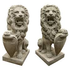 lions statues pair of modestly scaled vintage cast seated lion statues for