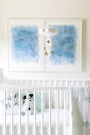 gold stars nursery mobile over crib transitional nursery