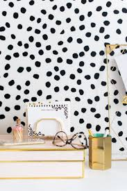 irregular dots wall pattern urban walls irregularly shaped vinyl black dots on a white wall behind a white desk in an office