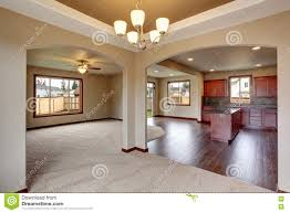 open floor plan interior with carpet and fireplace stock photo