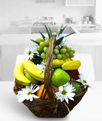 fruit flowers delivery fruit daisies a basket of delicious fruit accented with daisies