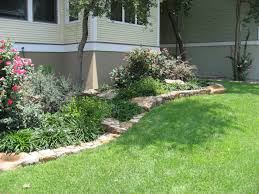 terrific landscape pink flowers bed edging with stone base design