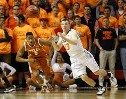 Texas what is traveling in basketball images Texas guard catches his own air ball and scores a layup jpg-4