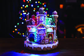 led gingerbread house with moving decorations