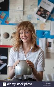 hair generator a hair raising schoolgirl using a van de graaff generator during a