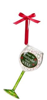 wine glass ornaments are topped with animal print fur