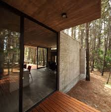 concrete home with a glass door that blends with surroundings