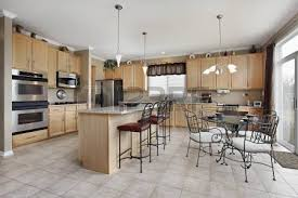large kitchen in luxury home with cabinetry stock
