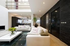 cuisine mur noir plancher beige poli comptoir de cuisine élégant et blanc tabouret