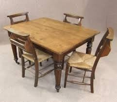 VICTORIAN PINE KITCHEN TABLE AND FOUR CHAPEL CHAIRS - Victorian pine kitchen table