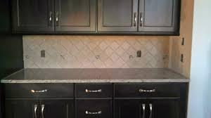 harlequin tile backsplash grey lacquer kitchen cabinets granite