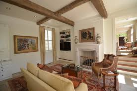 Traditional Interior Shutters Wood Beams On Ceiling Living Room Traditional With Cane Chair