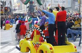 the wiggles in macy s yellow nyc taxicab make their way through