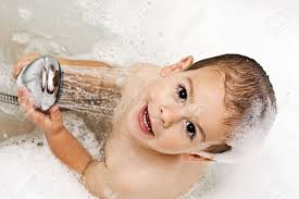 boy playing with shower stock photo picture and royalty free boy playing with shower stock photo 5565255