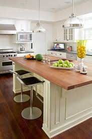 kitchen island with butcher block countertop transitional