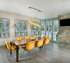 How High To Hang Pictures Decorating Dining Room With Crystal Chandelier And Unique Round