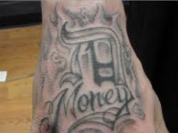 100 money tattoo design gangster with gun tattoo design on