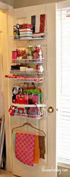 how to store wrapping paper and gift bags the door gift wrap storage use wide elastic to support gift