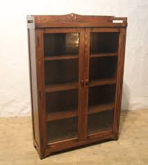 large bookcase with glass doors furniture brown wooden tall media cabinet with sliding glass