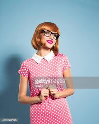polka dot hair hair woman wearing polka dot dress stock photo