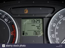 car dashboard car dashboard showing low fuel warning light stock photo royalty